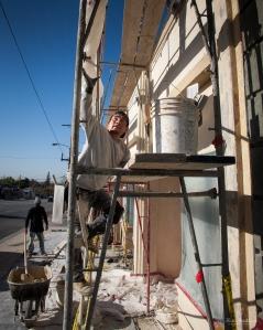 Worker climbing scaffolding.