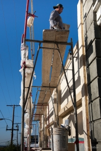 Worker on scaffolding.